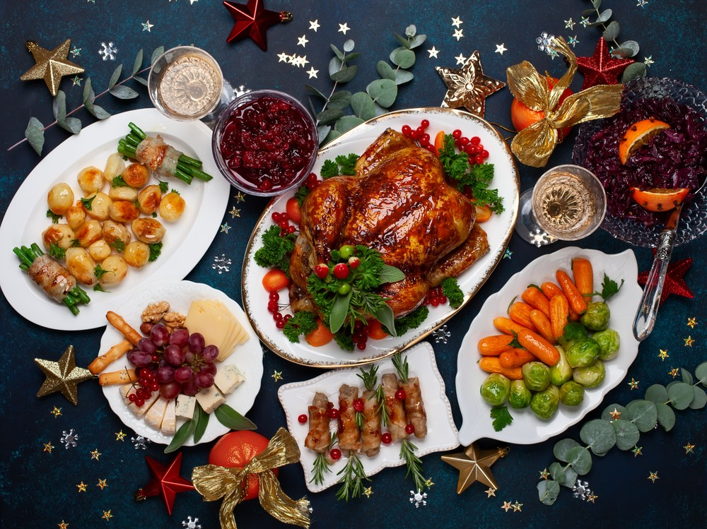 stock-photo-concept-of-christmas-or-new-year-dinner-with-roasted-chicken-and-various-vegetables-dishes-top-1214998951.jpg