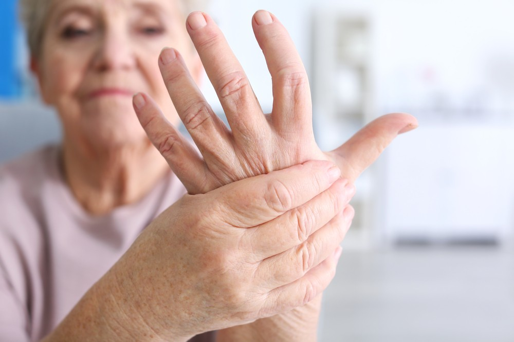 stock-photo-elderly-woman-suffering-from-pain-in-hand-closeup-566470942.jpg