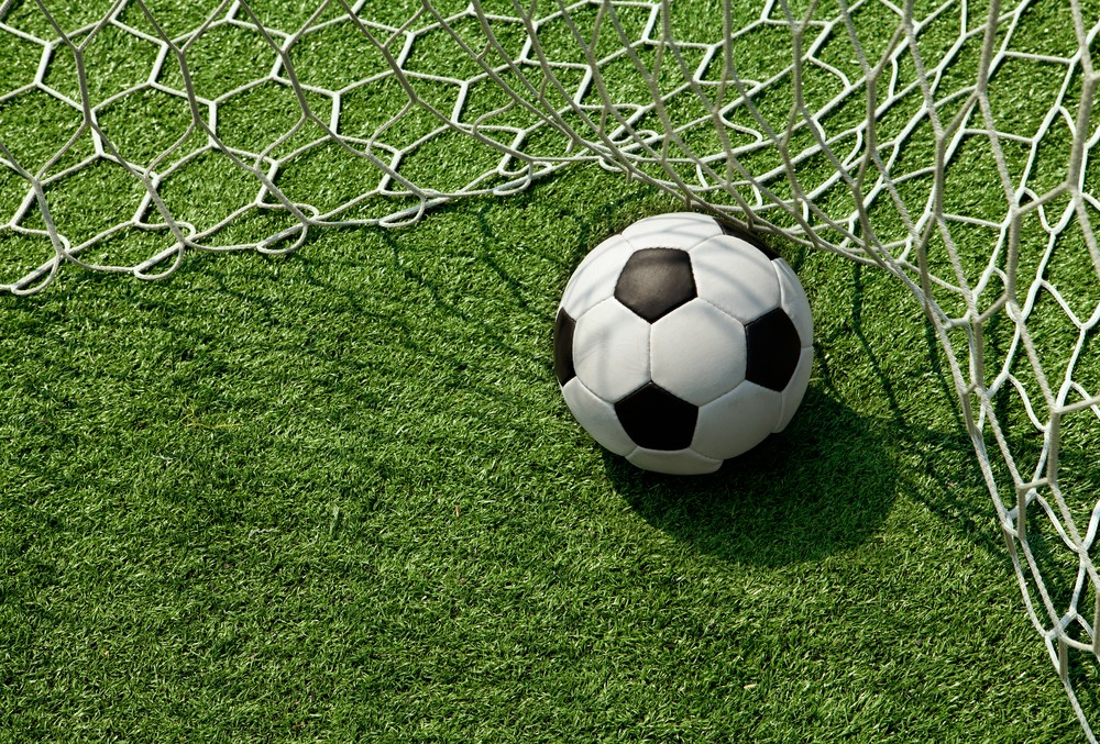 stock-photo-football-in-the-goal-net-82073227.jpg