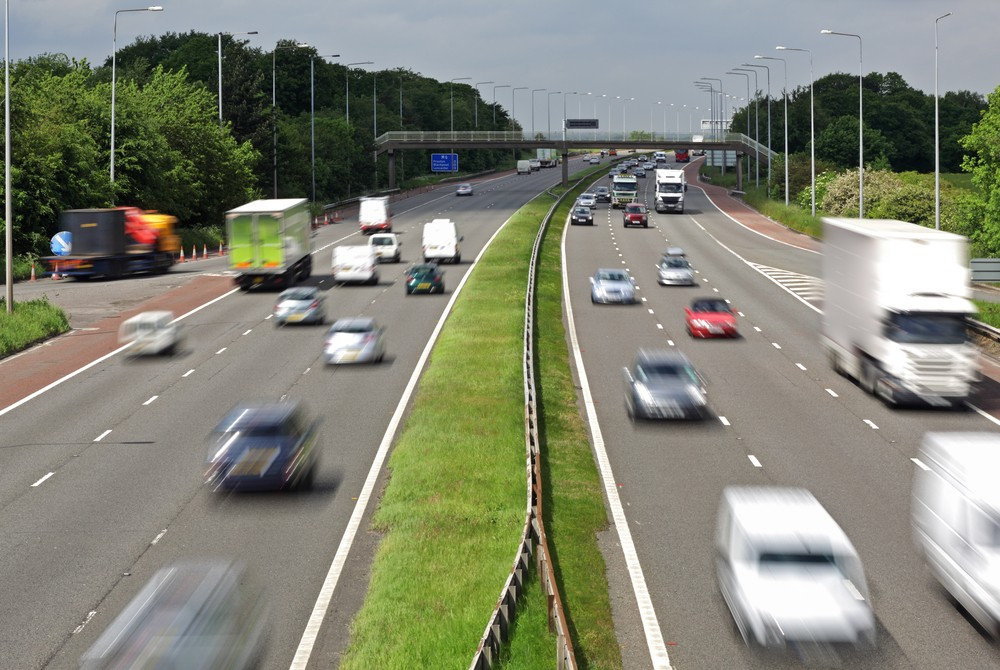 stock-photo-heavy-traffic-moving-at-speed-on-the-m-motorway-in-england-105275993.jpg