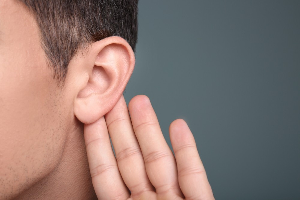 stock-photo-man-with-hearing-problem-on-grey-background-closeup-1009433224.jpg
