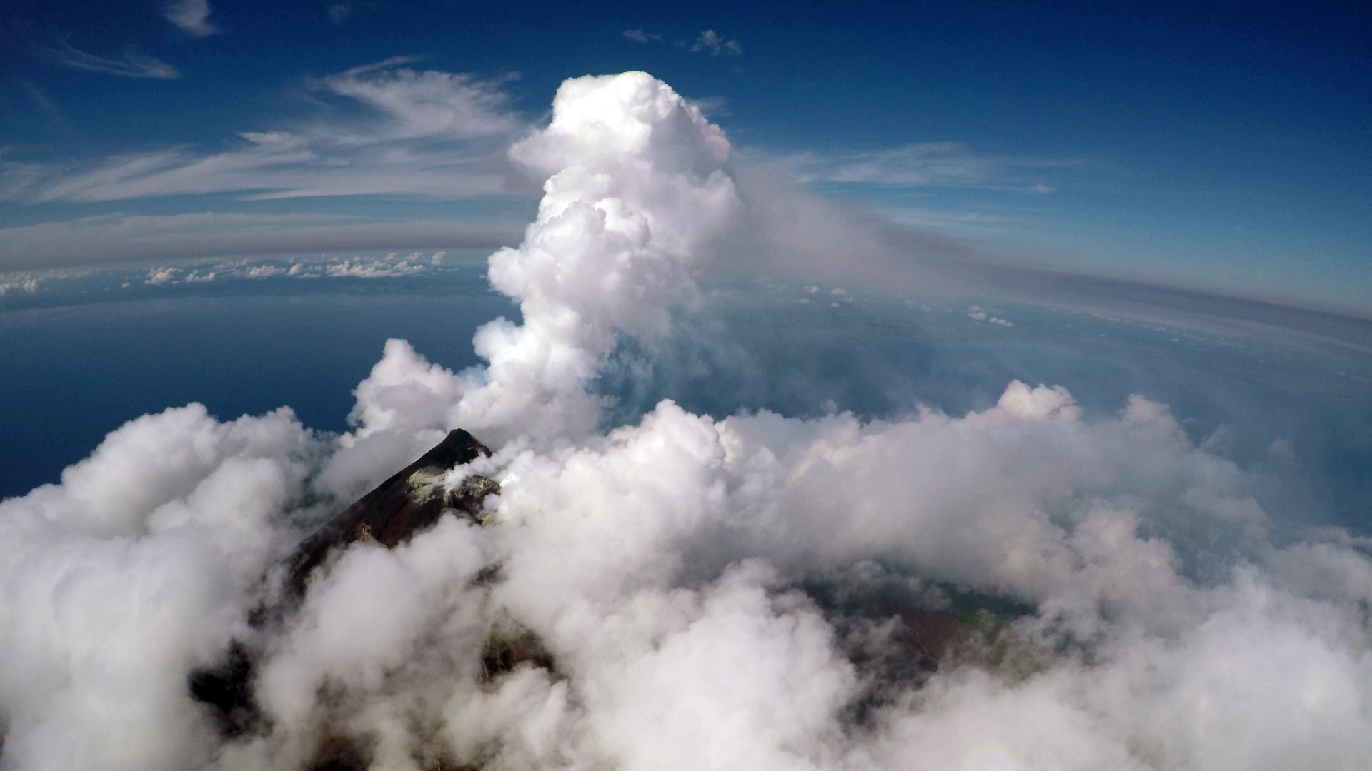 Aerial view of the active vent and gas plume of Manam volcano, Papua New Guinea, from a fixed-wing drone at 2300 m altitude. Credit - Matthew Wordell
