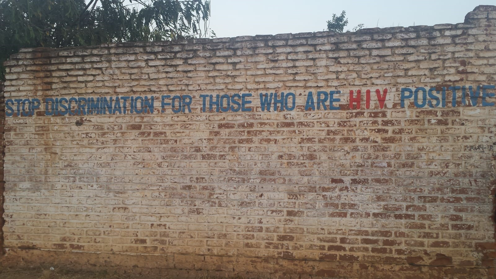 An anti-discrimination message written on a wall in Lilongwe.