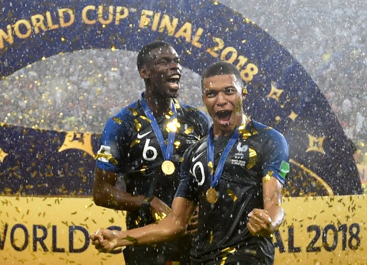 Paul Pogba and Kylian Mbappé, celebrate winning the World Cup