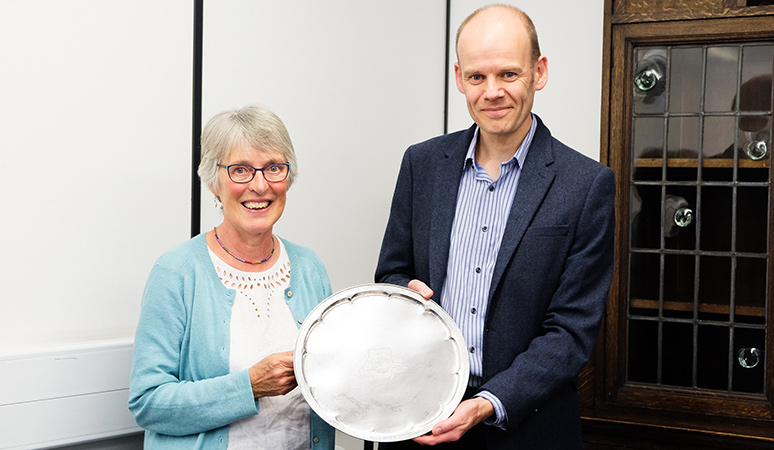 Dr Kirsten Lamb presents plate to Prof Oliver Jensen