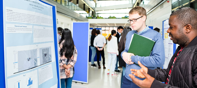 Applied Mathematics students presenting posters