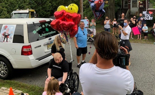 COVID survivor Colby Douglas is welcomed home by his community and news crews.