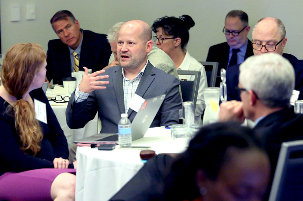 State Farm Counsel Ryan Gammelgard speaks  to other leaders during  a GHSA /State Farm forum on the future of automated vehicles.