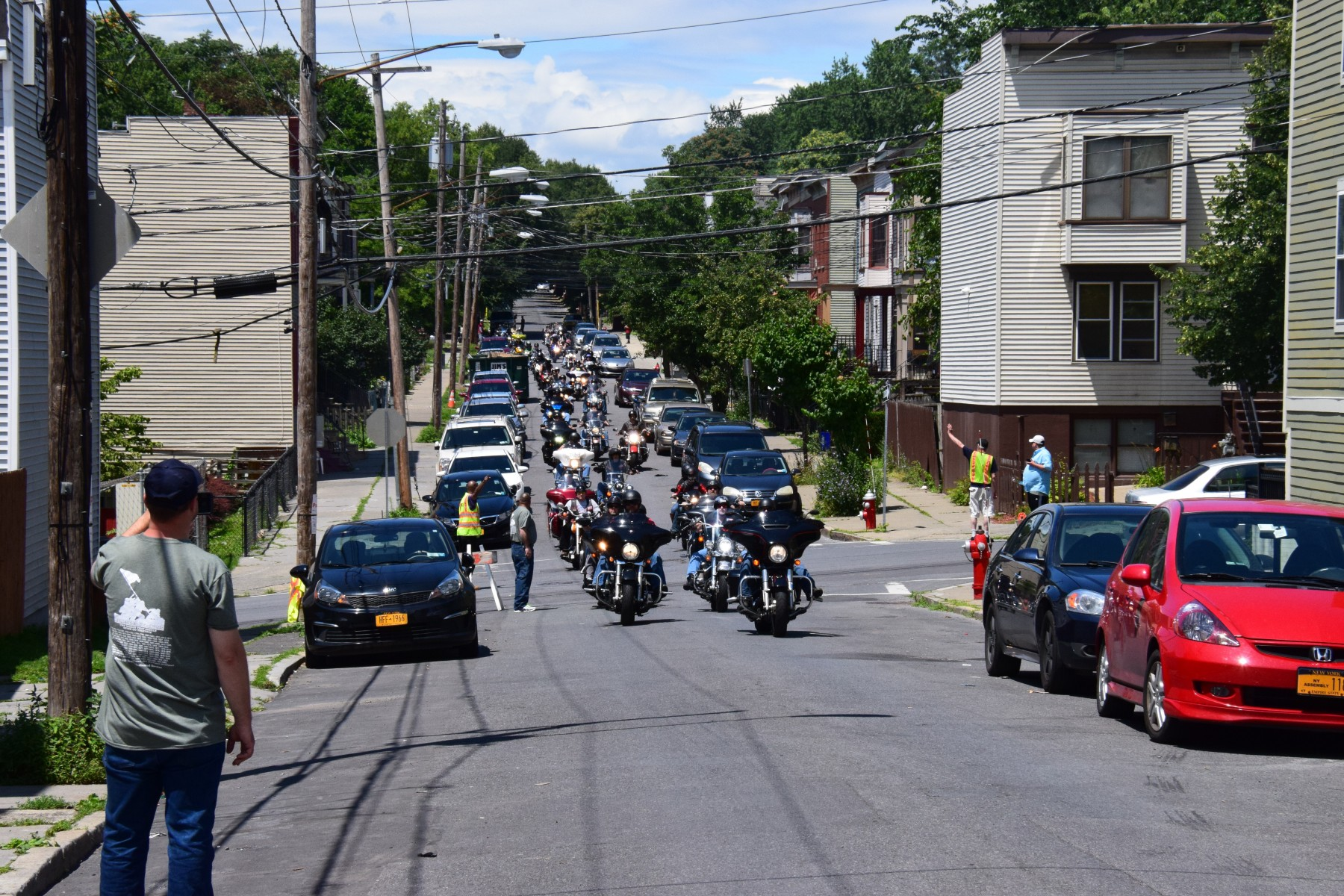 100 motorcyclists escorted a white, cargo van down an Albany, street.