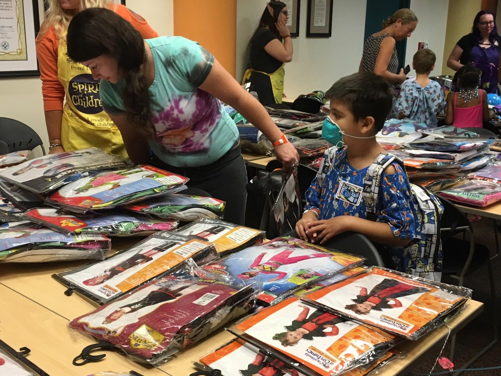 fox 4: spirit halloween donates dozens of costumes to kids at