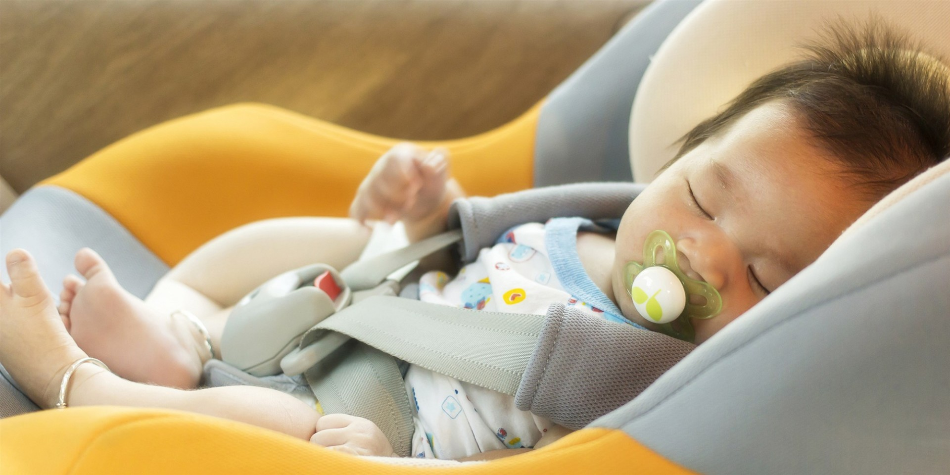 Sleeping baby in car seat