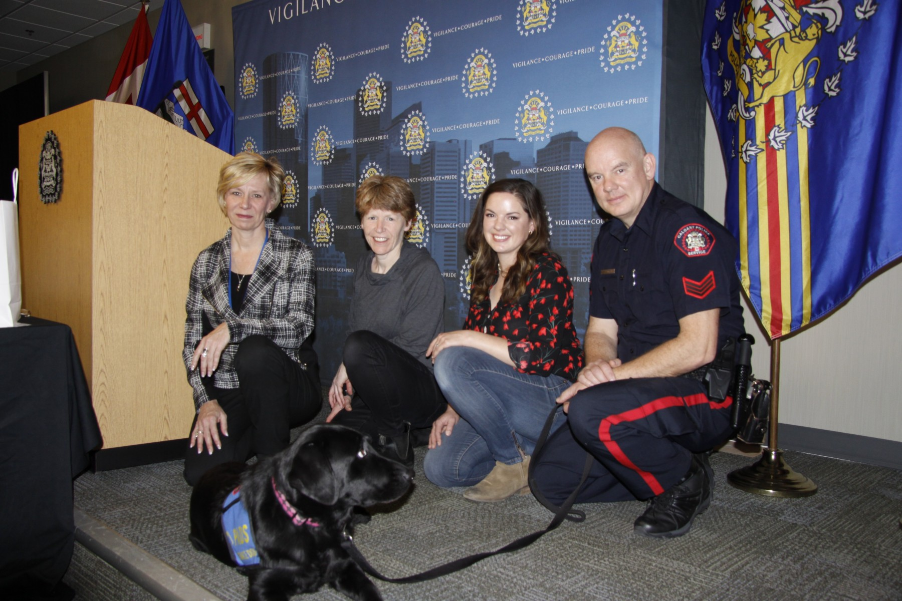 Pictured from left to right; Laura, Margaret and Miranda of Pacific Assistance Dogs Society (PADS), Cst. Steve Hill, Calgary Police Service, and Calibri, Justice Facility Dog, Calgary Police Service