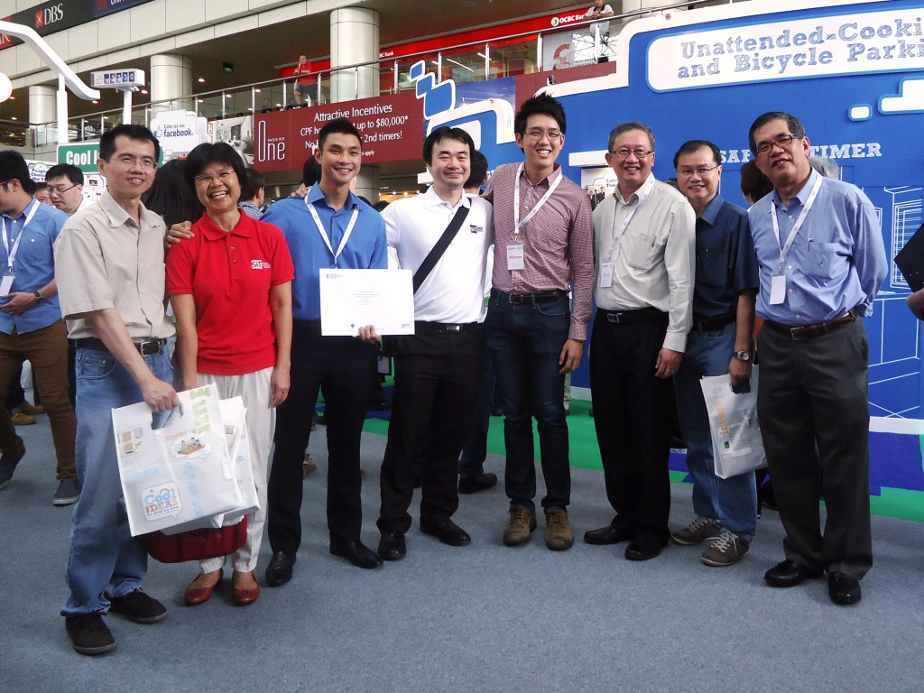 Team SITuations celebrates winning second place along with SIT staff at the Cool Ideas for HDB Living 2014 Exhibition on 29 March 2014 at HDB Hub. (From left) Asst Prof Alfred Tan, Kathrine Koo, Director, Student Life; Alex Woh Yu Ker, member of team SITuations; Asst Prof Edmund Liew, Programme Director;  Ernest Fong Tze Chow, leader of team SITuations; Prof Loh Han Tong, Vice-Provost; Woon Kok Meng, Director (Programmes Administration) and Programme Director; Prof Tan Thiam Soon, President, SIT. Photo | SIT Sarah Loh