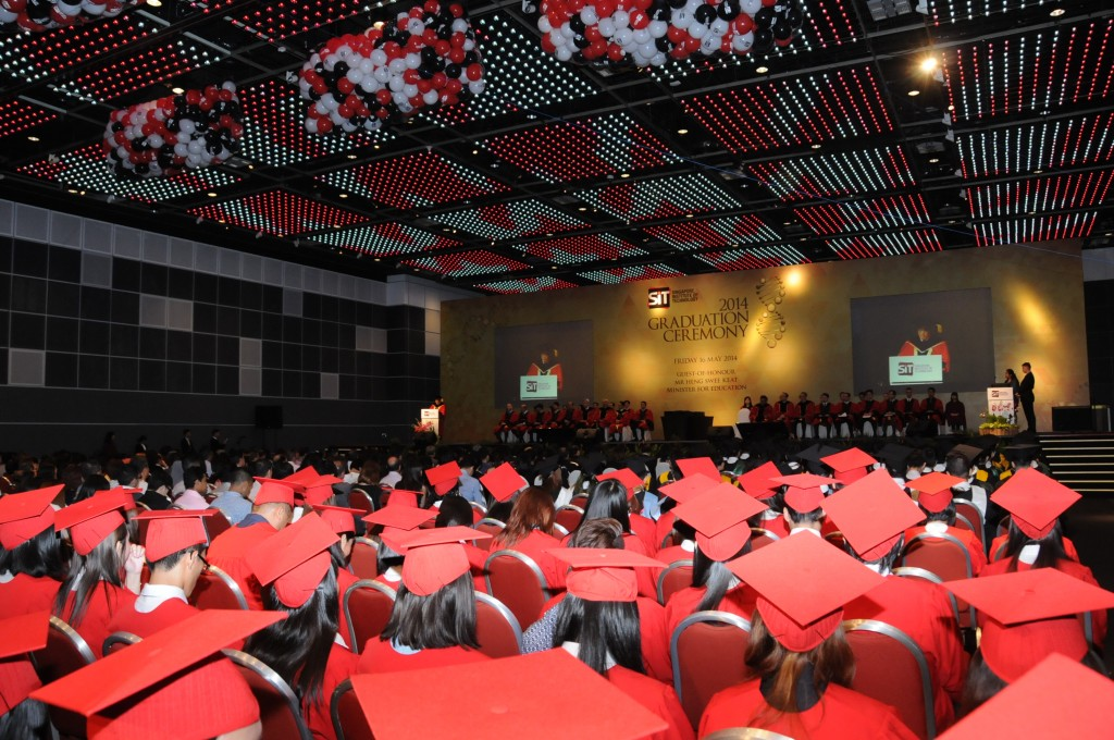 Students from the Technical University of Munich, in their red graduation gowns and caps listening to the opening address by guest of honour, Mr Heng Swee Keat, Minister for Education at the SIT Graduation Ceremony 2014 (16 March 2014). Photo | SIT