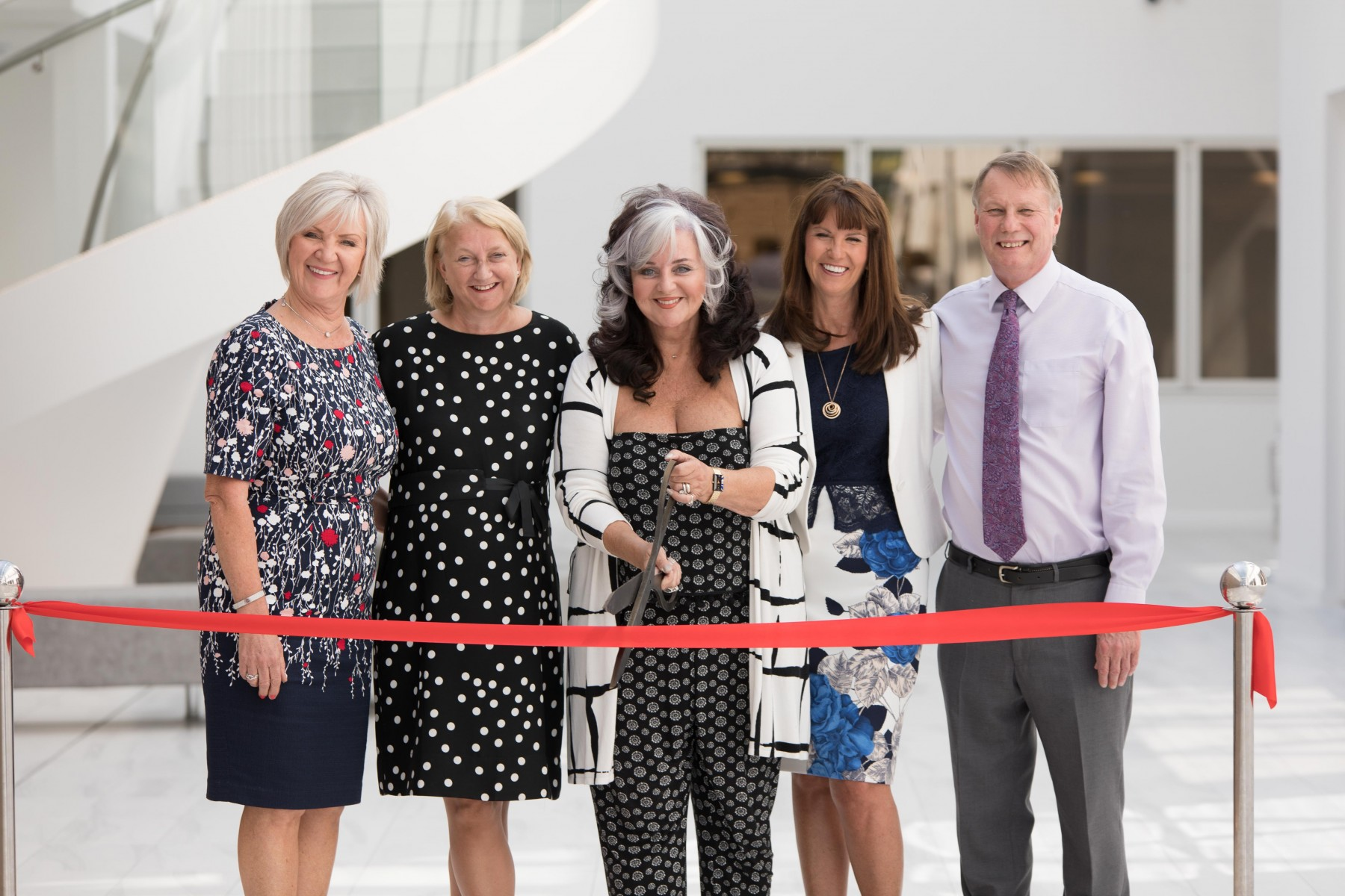 Slimming World founder Margaret Miles-Bramwell OBE and company directors cutting the ribbon at Slimming World's new head office extension