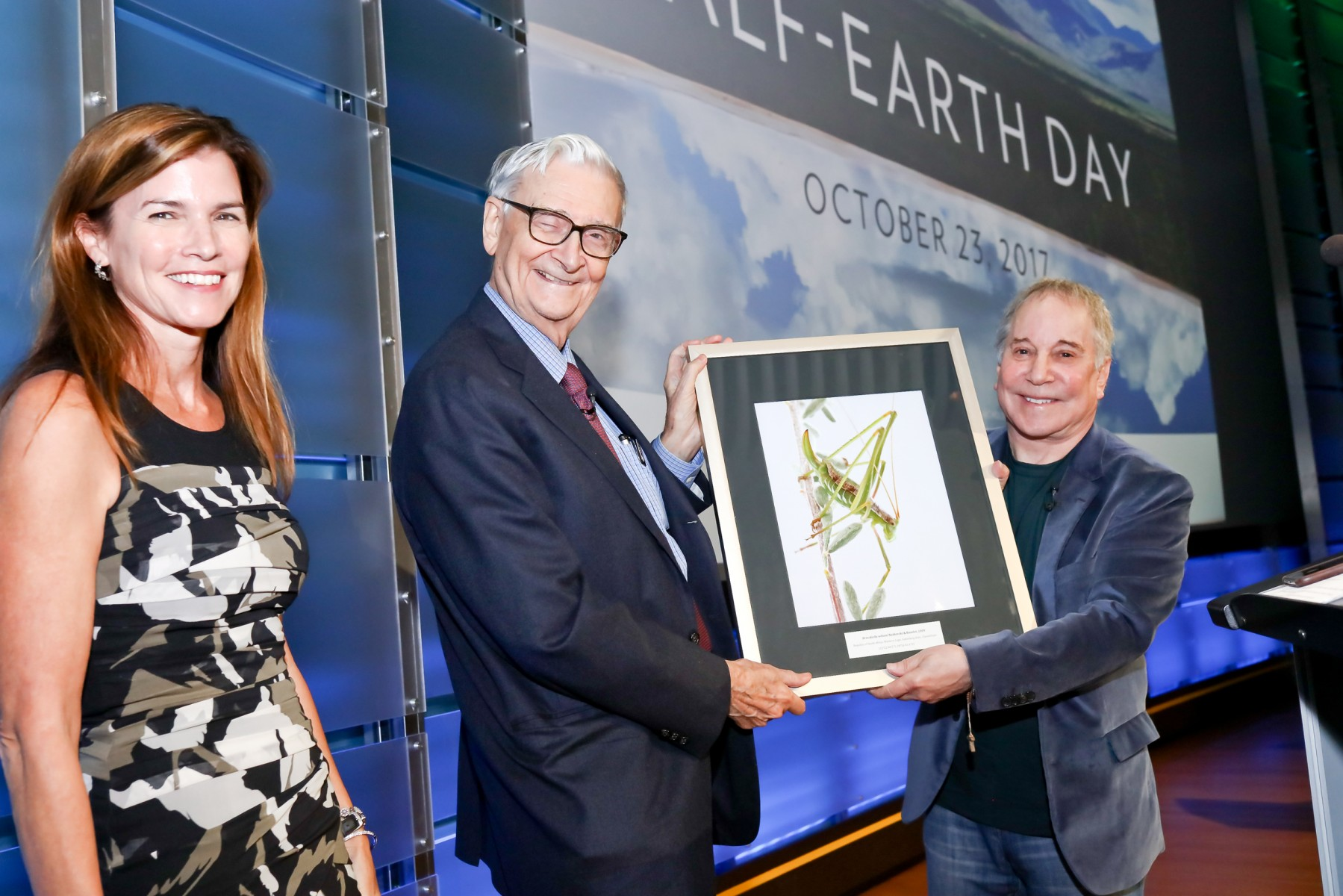E.O. Wilson Biodiversity Foundation president and CEO Paula Ehrlich (left) stands with eminent biologist Edward O. Wilson (center) and legendary recording artist Paul Simon (right) at the evening session of the planet's first-ever Half-Earth Day. The inaugural event was co-convened by National Geographic and the E. O. Wilson Biodiversity Foundation and held at the National Geographic Society in Washington, D.C. on Oct. 23, 2017.