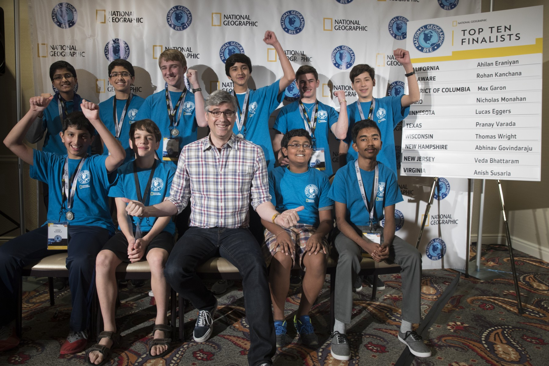 These top 10 finishers who competed in today's preliminary round of the 2017 National Geographic Bee held in Washington, D.C., will take part in the final round of the competition on Wednesday, May 17. They are (top row, left to right) Abhinav Govindaraju of New Hampshire, Veda Bhattaram of New Jersey, Lucas Eggers of Minnesota, Rohan Kanchana of Delaware, Thomas Wright of Wisconsin and Max Garon of the District of Columbia (bottom row, left to right) Anish Susarla of Virginia, Nicholas Monahan of Idaho, Mo Rocca, moderator of the 2017 National Geographic Bee,  Ahilan Eraniyan of California and Pranay Varada of Texas.