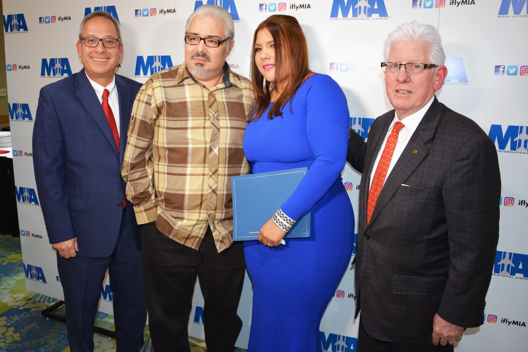 MDAD Director and CEO Lester Sola, cardiac arrest survivor Luis Ramos, MIA Employee of the Year Anabella Zapata, and Bill Talbert, President and CEO, Greater Miami Convention and Visitors Bureau