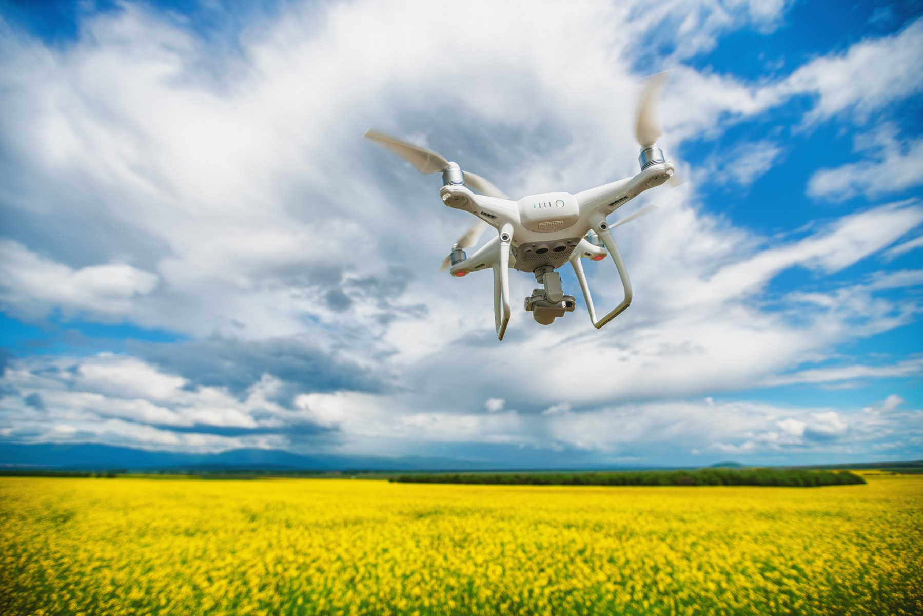 GettyImages-936319336_drone_over_field