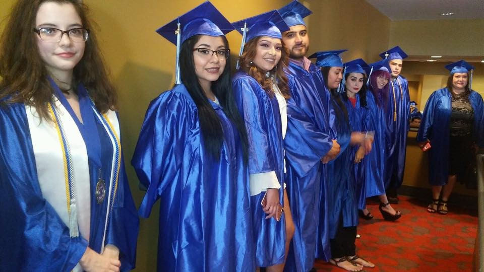 High School Equivalency graduates lining up to walk the stage during a past ceremony