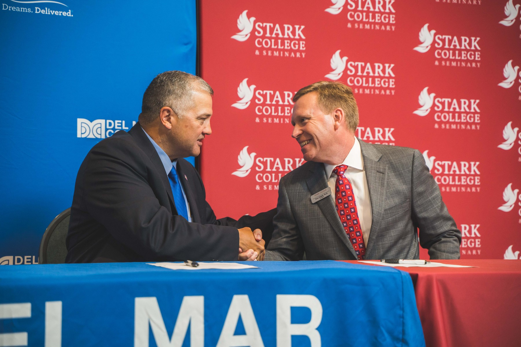 Stark College MOU_Presidents Mark Escamilla (left) and Tony Celelli_handshake at table_081410