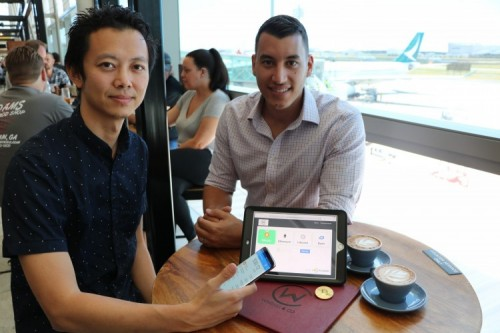 Caleb Yeoh from TravelbyBit and George Drivas Windmill & Co. try out the new cryptocurrency option at Brisbane Airport