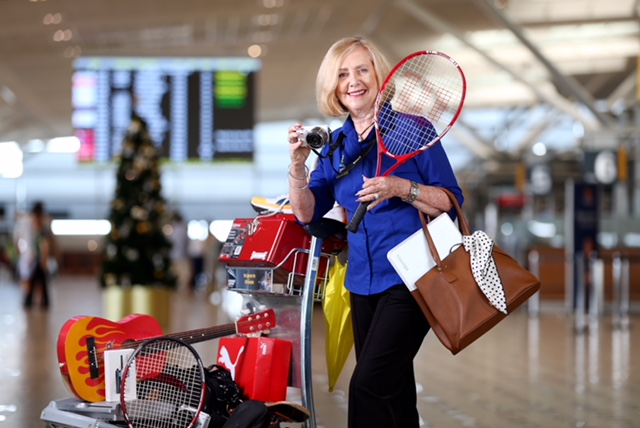 Bev Stephens with a bunch of items ahead of Brisbane Airport's lost