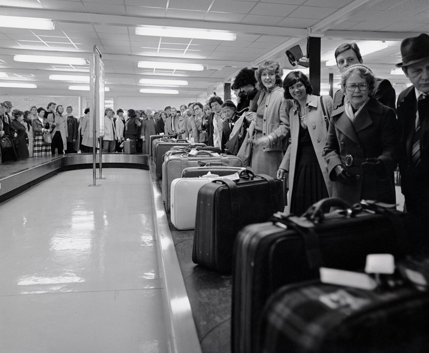 A busy baggage hall in the seventies.