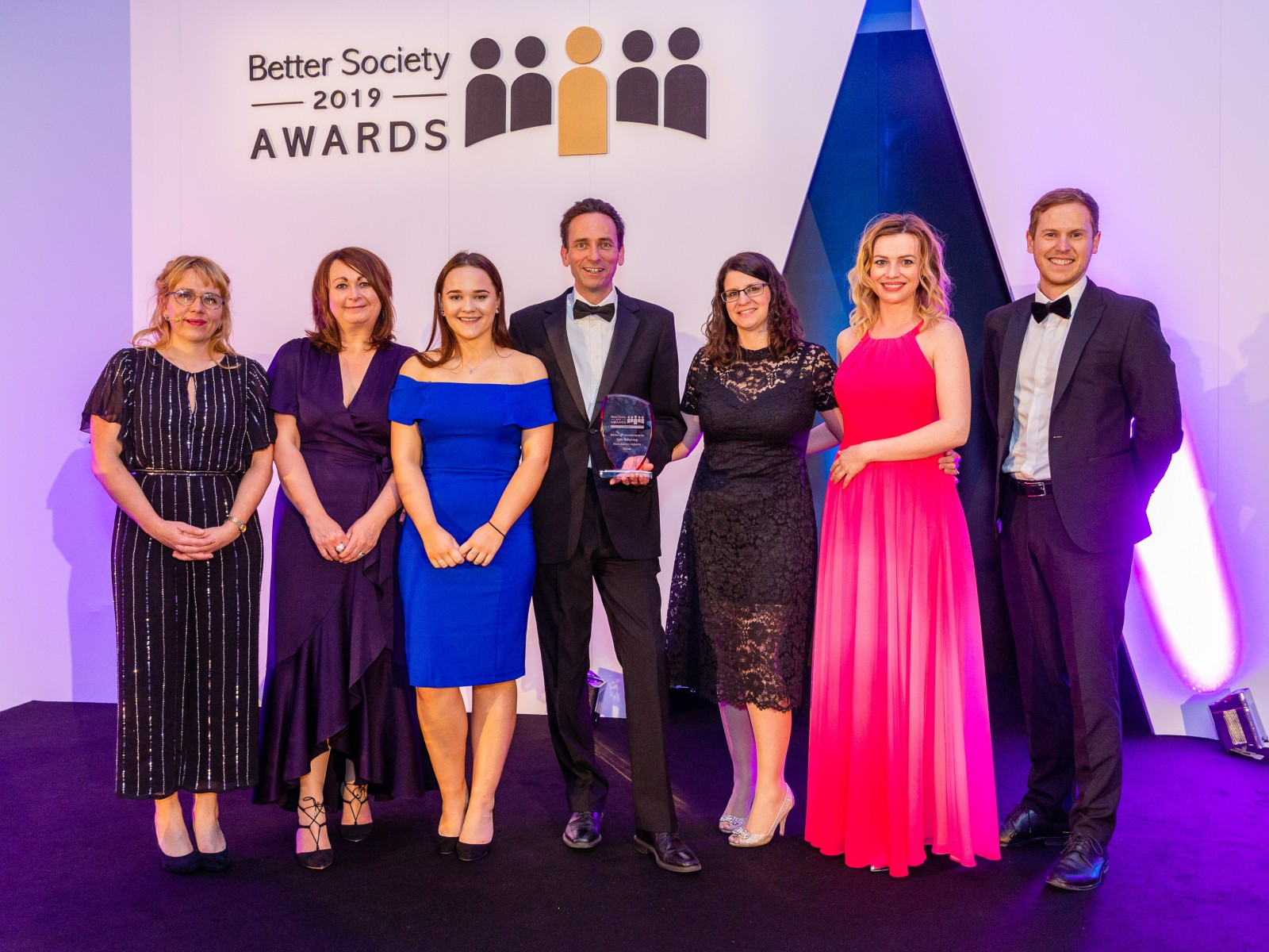 Representatives from MAG, including Stansted Airport's Head of Corporate Social Responsibility, Marcella M'Rabety (second in from the left), collect the National Commitment to Skills and Training prize at the 2019 Better Society Awards.