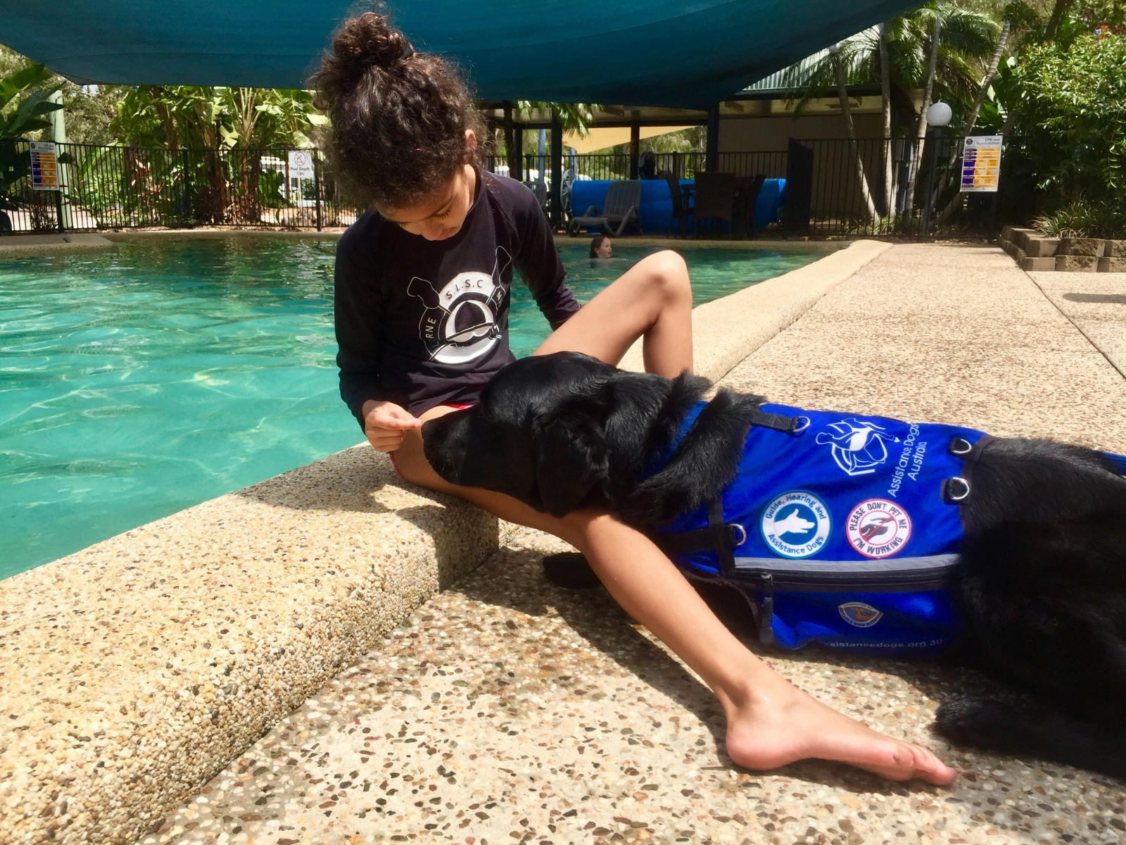 By the pool with autism service dog