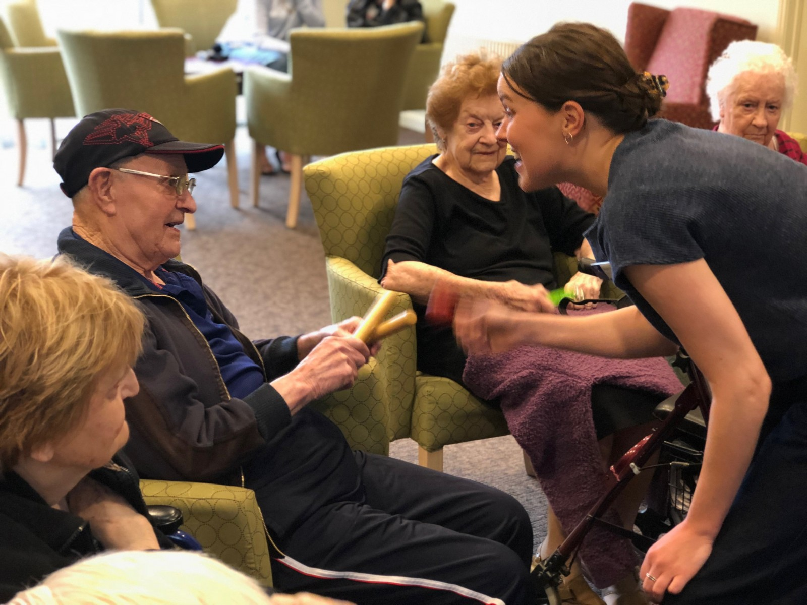 Professor Felicity Baker works with Bupa residents as part of music therapy.