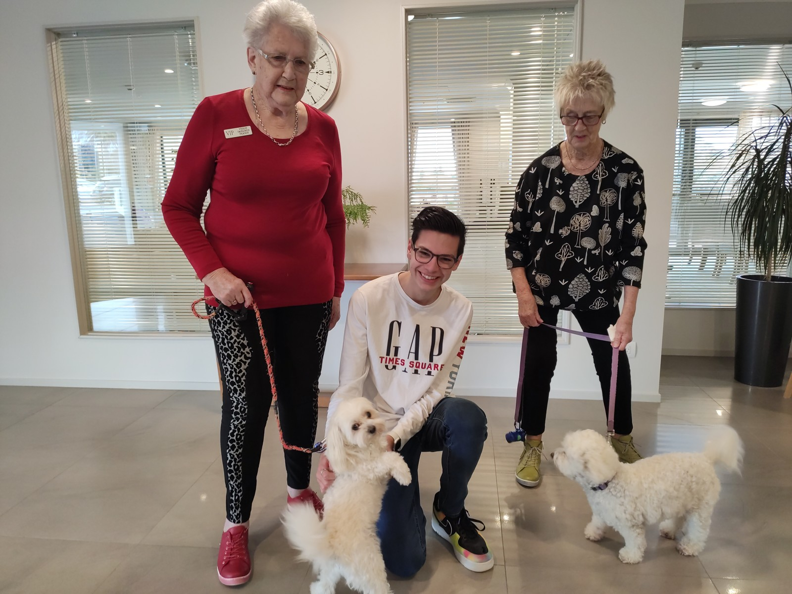 (Left to right) resident Marj Collett with her dog Snow, Daniel Cruickshank, resident Pat Horsley with her dog Timmy.