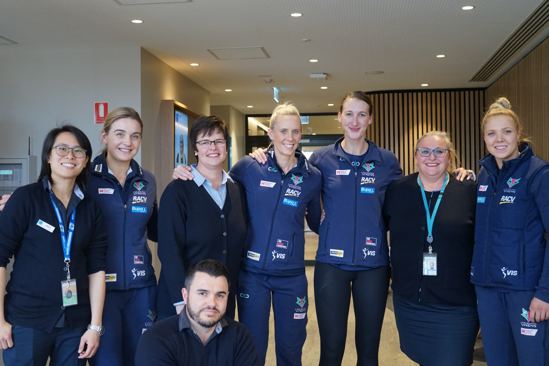 Melbourne Vixen Netballers With Bupa Therapy team