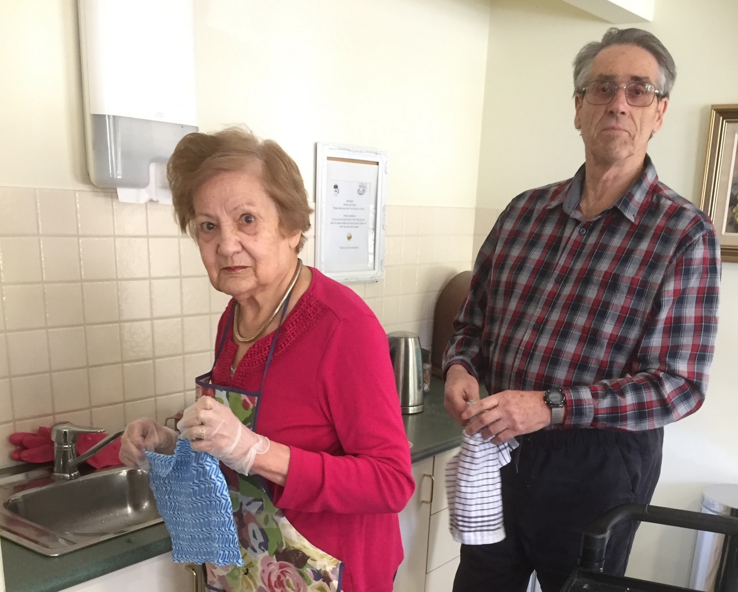 People with dementia engage in activity that is meaningful to them in different ways. Thelma and Barry enjoy washing and drying dishes.