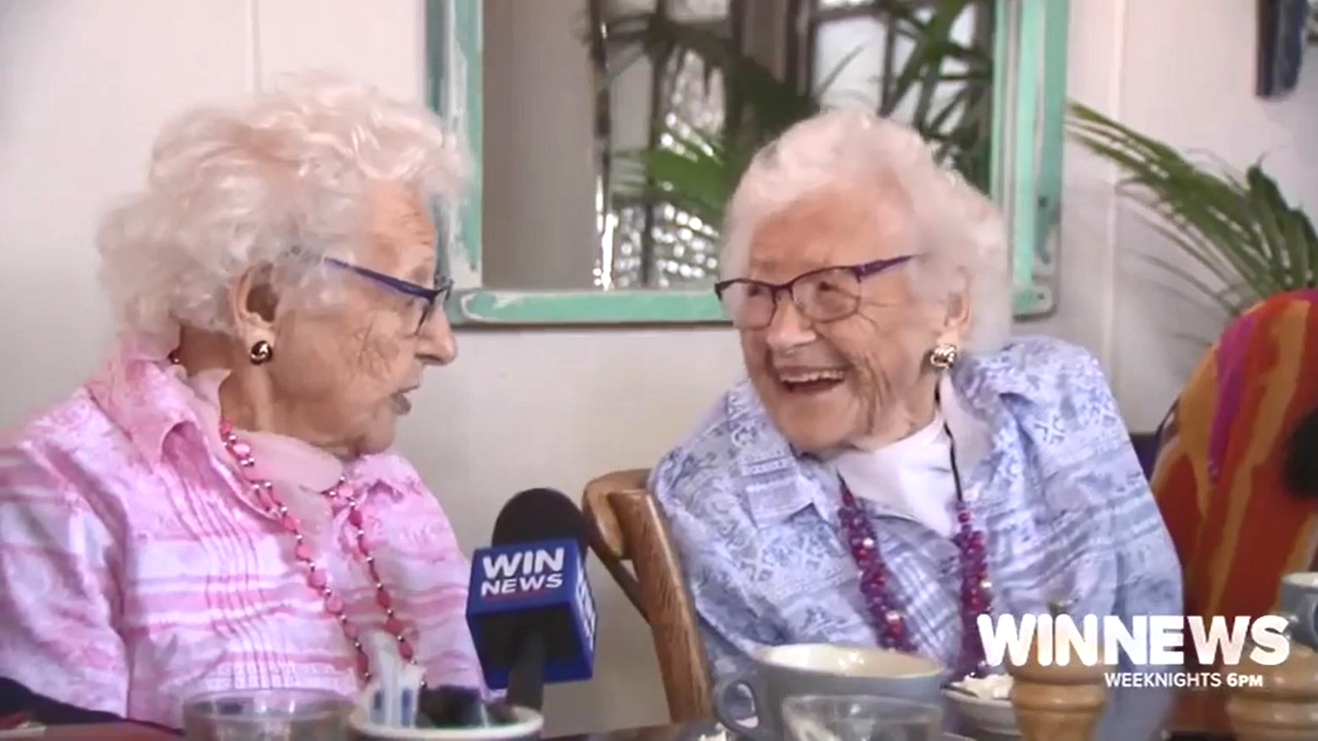 Twins laughing on their 100th birthday