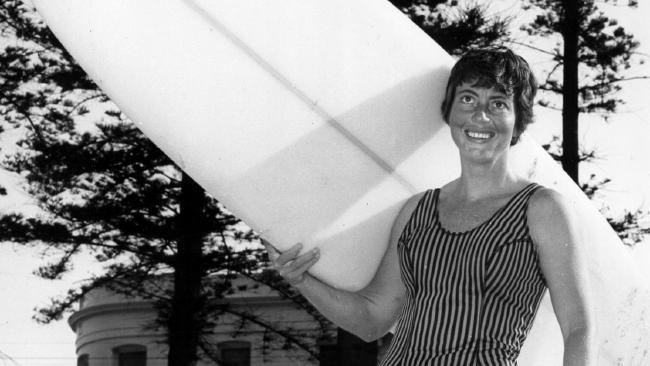 Phyllis with her Joe Larkin board. Credit: Australian National Surfing Museum.