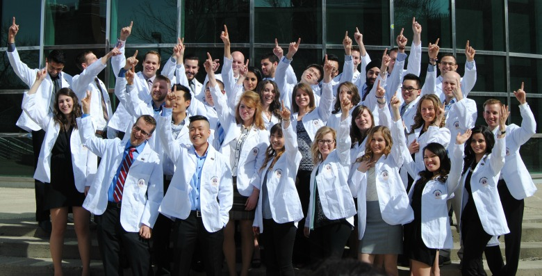 Members of UAlberta's dentistry class of 2016 celebrate their second-year milestone at the 13th annual White Coat Ceremony at the Timms Centre April 30.