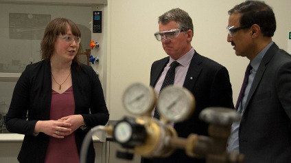 Sarah Styler discusses her research with UAlberta president David Turpin and Infrastructure and Communities Minister Amarjeet Sohi in her lab.