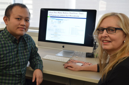Researchers Hein Min Tun (left) and Anita Kozyrskyj found that babies from families with pets had more of two types of gut bacteria that may protect them from allergies and obesity.