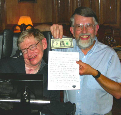 Don Page holds the Marilyn Monroe dollar bill he won from Stephen Hawking in 2007 in a bet over whether information that disappears into black holes is lost forever. (Photo courtesy Don Page)