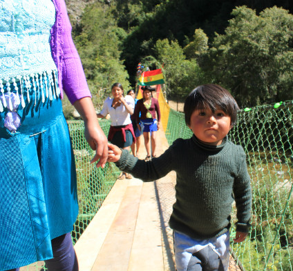 A young child crosses the new footbridge in Chavarria, Bolivia. (Photo courtesy Mabel Smith)