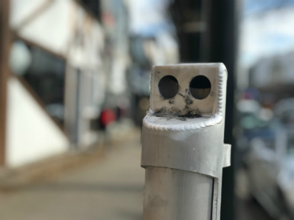 The new street ashtrays have openings on the side to protect against the elements, and are easier to clean. (Photo: Geoff McMaster)