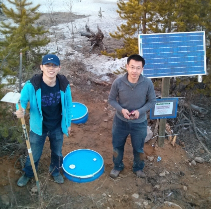 Yunfeng Chen (left) and Jeffrey Gu work in the field at a seismic station in the Canadian Rocky Mountains. (Photo: Supplied)