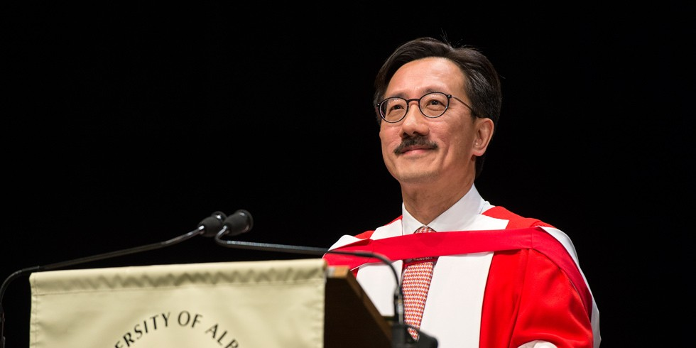 Honorary doctor of laws John Poon addresses graduands of the Alberta School of Business during their convocation ceremony June 9. (Photo: Richard Siemens)