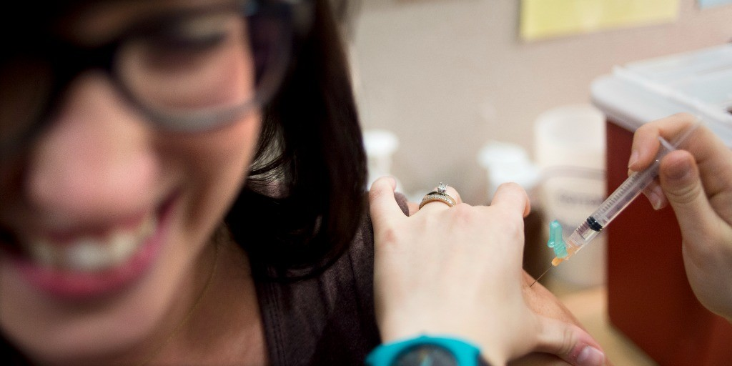Melissa Williams, left, receives a flu shot from Beth Woytas at the University Health Centre on October 12, 2012.