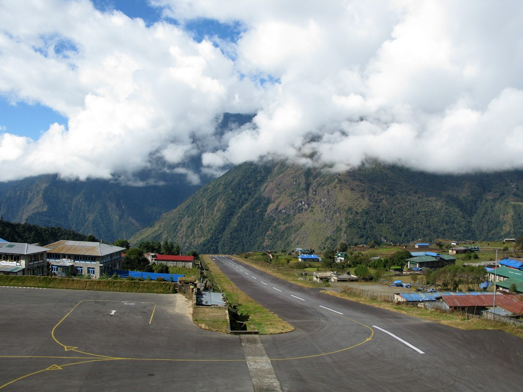 The 500-metre airstrip at Lukla Airport has a cliff at one end and a mountainside at the other. (Photo: Allan Grey via Flickr, CC BY-SA 2.0)