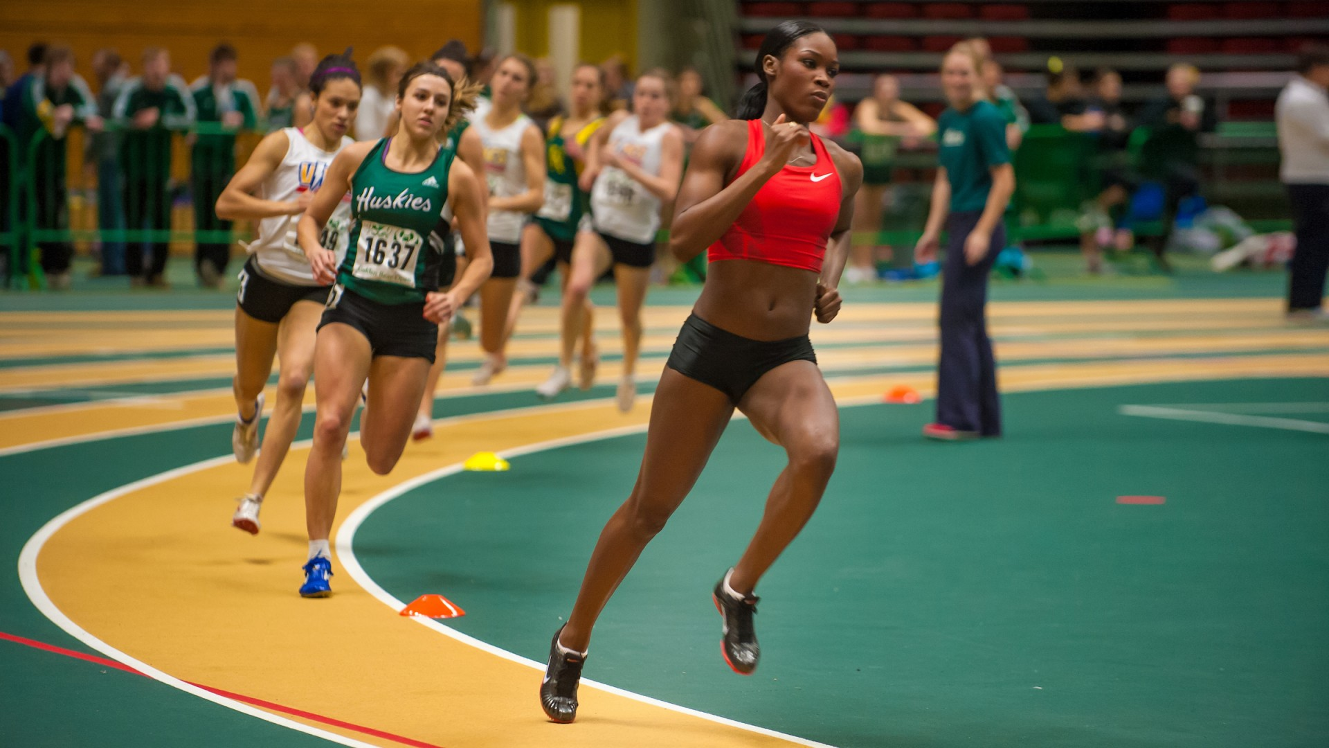 Carline Muir, who graduates with a Bachelor of Arts in Recreation, Sport and Tourism June 14, is seen here running to victory at the 40th Annual Golden Bear Open Track and Field Meet held at the U of A Butterdome in 2012. (Photo by Richard Siemens)