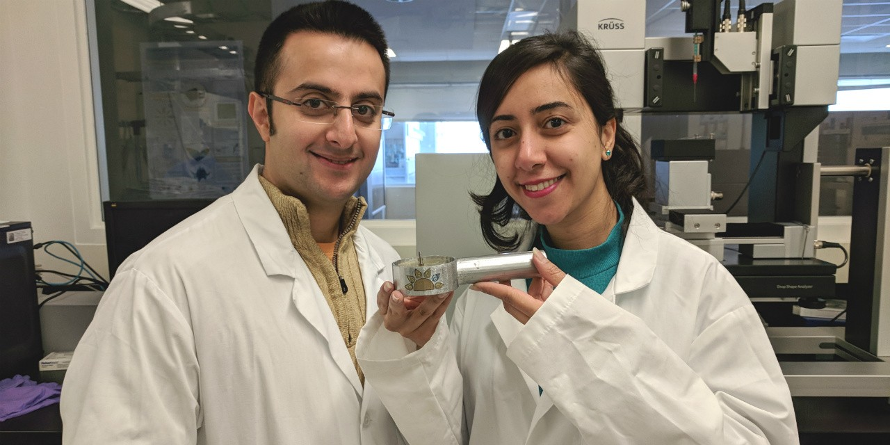 Amirreza Sohrabi (left) and Parmiss Mojir Shaibani with their prototype for a handheld sensor that can detect E. coli bacteria in water much sooner than current methods.