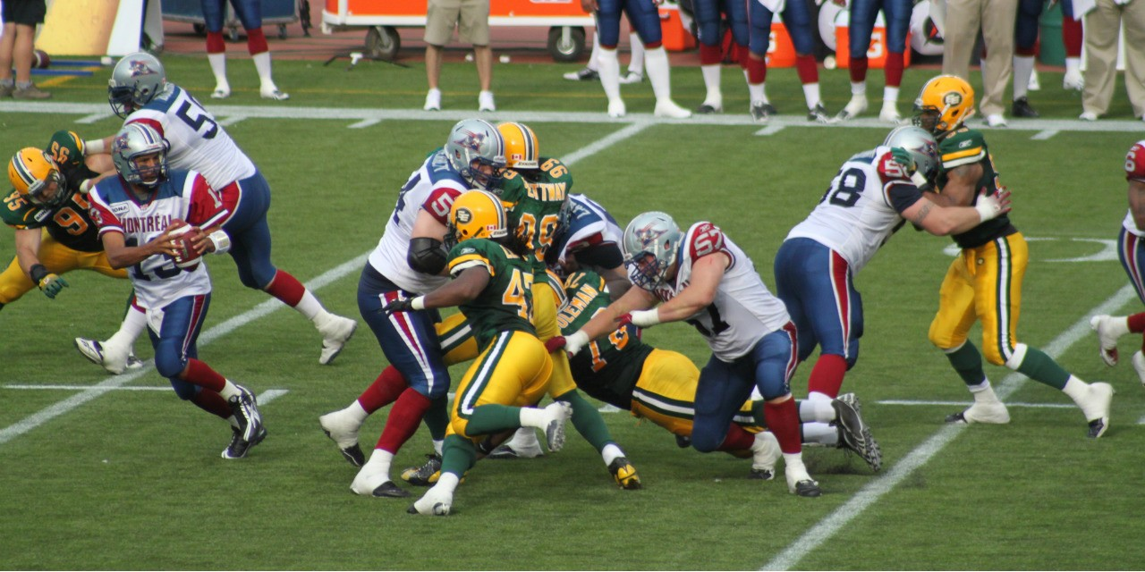 The Edmonton Eskimos football team (in green and gold) needs a new name, says an Inuit PhD student at UAlberta. (Photo: Shawn McCready via Flickr)