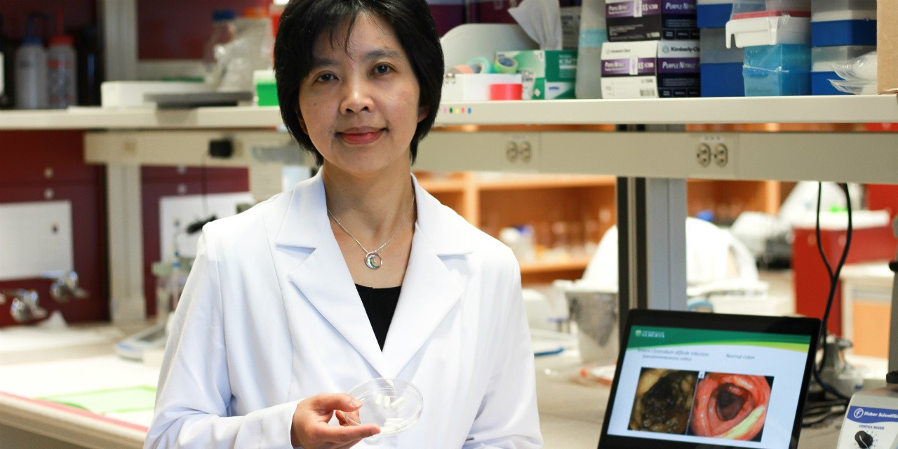 Gastroenterologist Dina Kao with a sample of fecal transplant capsules. Kao was lead author of a study showing that the capsules were as effective as a colonoscopy at treating C. difficile infection. (Photo: Melissa Fabrizio)